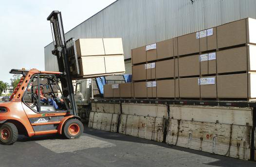 Packs of MDP panels being loaded onto a truck for distribution to Duratex's customers