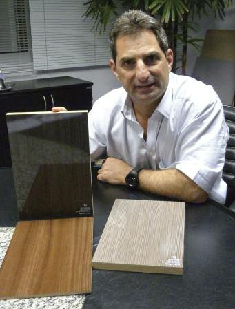 Eucatex's executive president with some finished products including high-gloss MDF