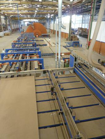 A view of the EMG-supplied saw, handling and finishing sections of Eucatex's new MDF/HDF line, prior to its launch at Salto